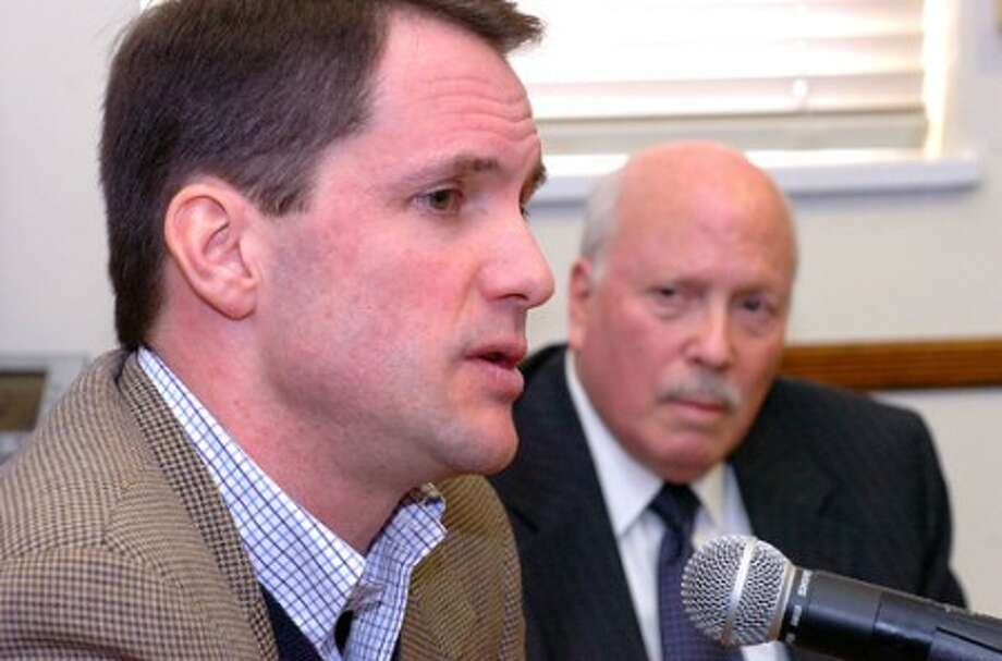 Photo/Alex von Klkeydorff. Jim Himes answers a question about immigration with Gordon Joseloff at Westport Town hall.