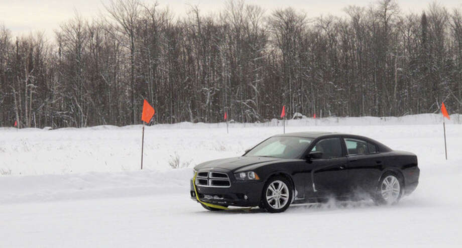 In this Jan. 21, 2012 photo, a student practices keeping control of a car on a snow-covered course during the Keweenaw Research Center's winter driving school near Hancock, Mich. The school helps new and veteran drivers learn how to avoid crashes while driving on snowy roads. (AP Photo/John Flesher) / AP