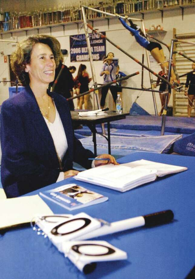 Alison Laney is a former Norwalk High School gymnast in the late 1970s and early 1980s and is now one of the top high school gymnastics judges in the FCIAC. Hour photo / Erik Trautmann