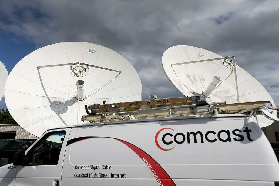 A Comcast truck is seen parked at one of their centers on February 13, 2014 in Pompano Beach, Florida. (Photo by Joe Raedle/Getty Images) Photo: Joe Raedle