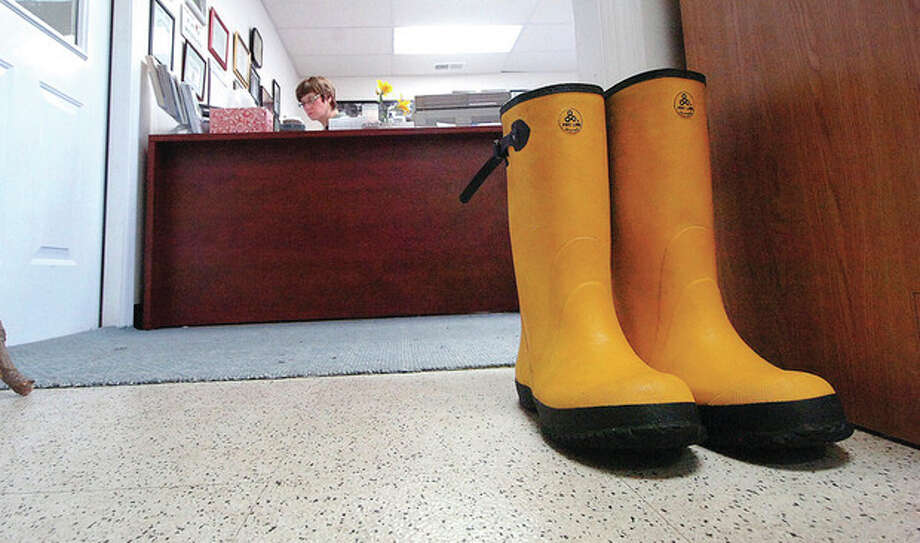 Hour Photo/ Alex von Kleydorff. Rubber boots are ready at the Shelter / © 2012 The Hour Newspapers