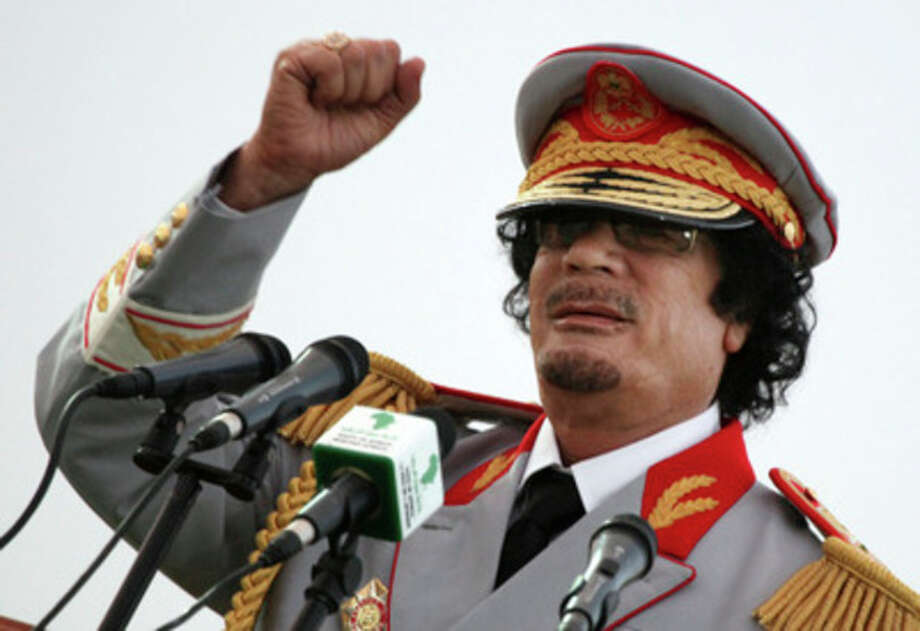 FILE - In this Saturday, June 12, 2010 file photo, Libyan leader Moammar Gadhafi talks during a ceremony to mark the 40th anniversary of the evacuation of the American military bases in the country, in Tripoli, Libya. The Associated Press is aware of reports that Moammar Gadhafi has been captured in Sirte. The chief spokesman for the revolutionary National Transitional Council Jalal el-Gallal and the council military spokesman Abdul-Rahman Busin told the AP that those reports are unconfirmed. (AP Photo/ Abdel Magid Al Fergany, File) / AP