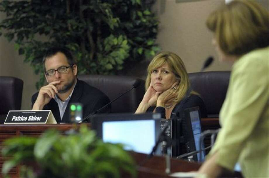 In a April 27, 2011 photo, committee members Jason Searl, left, and Patrice Shirer, center, listen as Zoraida Rios-Andino addresses the group during a meeting of the Orange County Redistricting Advisory Committee in Orlando, Fla. Census data released Thursday, May 5, 2011 show the number of Central and South Americans in Florida grew by more than a half million people. (AP Photo/Phelan M. Ebenhack)