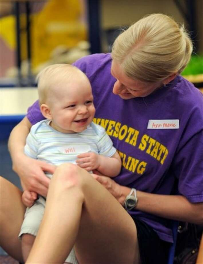 In this May 11, 2011 photo, Ann Marie Beste and her eighth-month-old son Will play together during at an Early Childhood Family Education program in Waconia, Minn. The district''s elementary schools are so packed, they had to create space in one of the district warehouses for early childhood classes. (AP Photo/Craig Lassig)