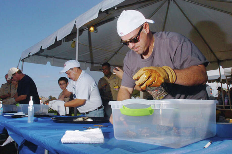 Norwalk resident Claudio Ronzitti competes in the Oyster Shucking Contest at the 2011 Norwalk Seaport Association Oyster Festival Saturday at Veteran's Memorial Park. / (C)2011, The Hour Newspapers, all rights reserved