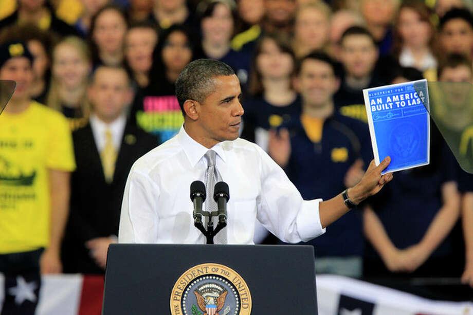 President Barack Obama speaks at the University of Michigan's Al Glick Field House, Friday, Jan. 27, 2012, in Ann Arbor, Mich. (AP Photo/Carlos Osorio) / AP