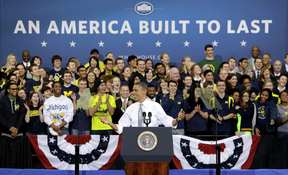 President Barack Obama speaks at the University of Michigan's Al Glick Field House, Friday, Jan. 27, 2012, in Ann Arbor, Mich. (AP Photo/Carlos Osorio) / AP