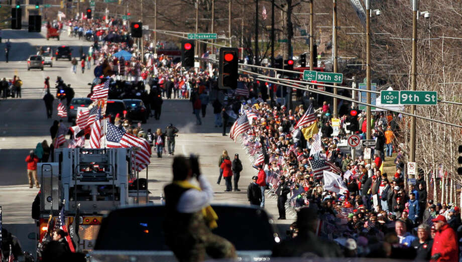 Thousands line a downtown street to watch a parade to honor Iraq War veterans Saturday, Jan. 28, 2012, in St. Louis. It is believed to be the first big welcome home parade in the U.S. since the last troops left Iraq in December. (AP Photo/Jeff Roberson) / AP