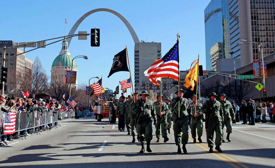 Participants in a parade to honor Iraq War veterans make their way along a downtown street Saturday, Jan. 28, 2012, in St. Louis. Thousands turned out to watch the first big welcome home parade in the U.S. since the last troops left Iraq in December. (AP Photo/Jeff Roberson) / AP