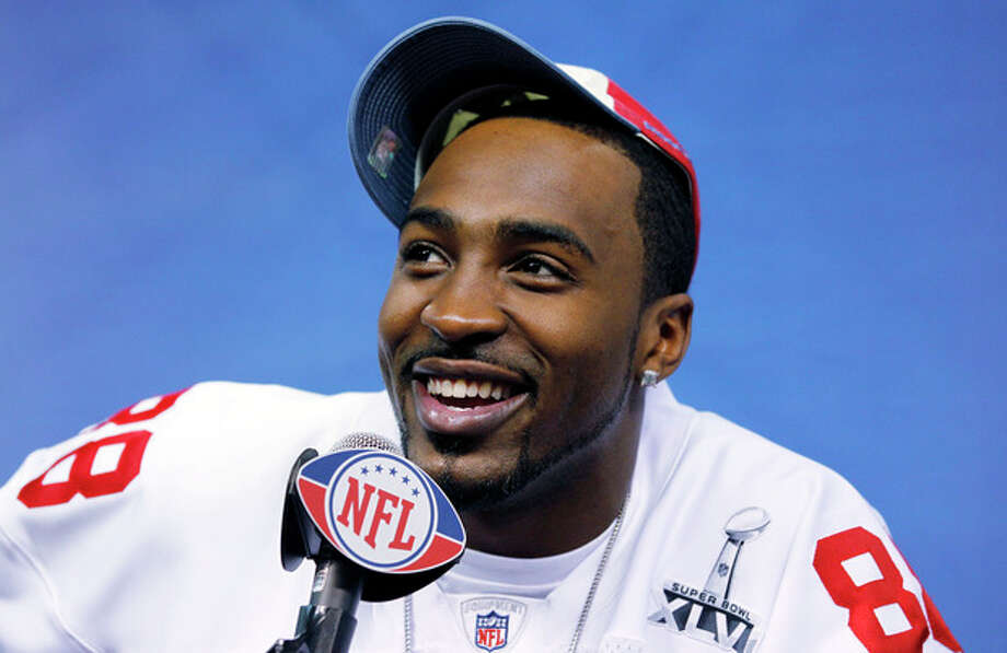 New York Giants wide receiver Hakeem Nicks smiles during Media Day for NFL football's Super Bowl XLVI Tuesday, Jan. 31, 2012, in Indianapolis. (AP Photo/Michael Conroy) / AP