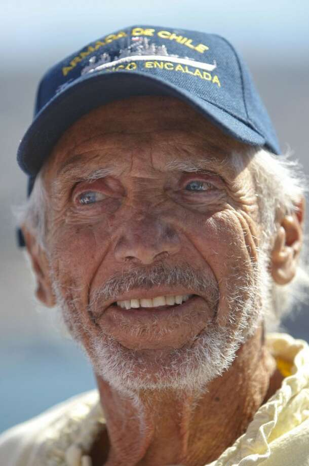 U.S. sailor Thomas Louis Corogin smiles after arriving to the port of Valparaiso, Chile, Monday, Jan. 9, 2012. The 84-year-old American who put out an emergency distress signal on Jan. 2, 2012 after cracks in his mast made it impossible for him to raise his sails, is in good condition. Chile's navy rerouted a Japanese merchant ship to his location. (AP Photo/Roberto Candia)