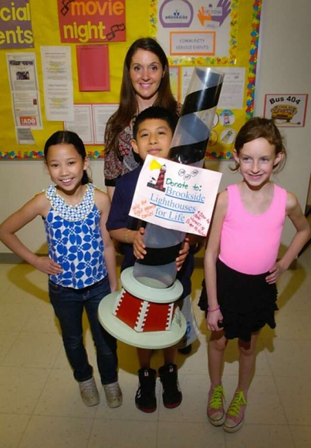 Brookside Elementary School 2nd grade teacher Jennifer Sweeters and 3rd graders Briana Maranon, Andy Velazquez and Caroline Petropolous lead the Brookside Lighthouse for Life team raising money for Relay for Life. Hour photo / Erik Trautmann