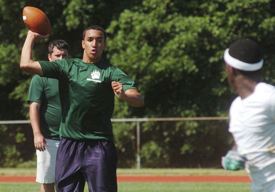 Hour Photo/Erik Trautmann Norwalk High senior Delshawn Wilson looks to pass the ball during the annual Ò7-on-7 Rip It and Grip It TournamentÓ at New Canaan High School Saturday. / (C)2011, The Hour Newspapers, all rights reserved