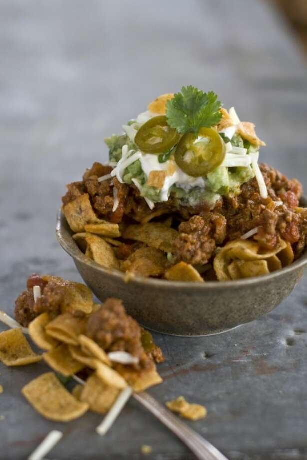 This Jan. 4, 2012 photo shows Elizabeth Karmel's recipe for a walking taco served in a bowl in Concord, N.H. A make-your-own taco bar is dramatic, and is easy on the cook. (AP Photo/Matthew Mead)