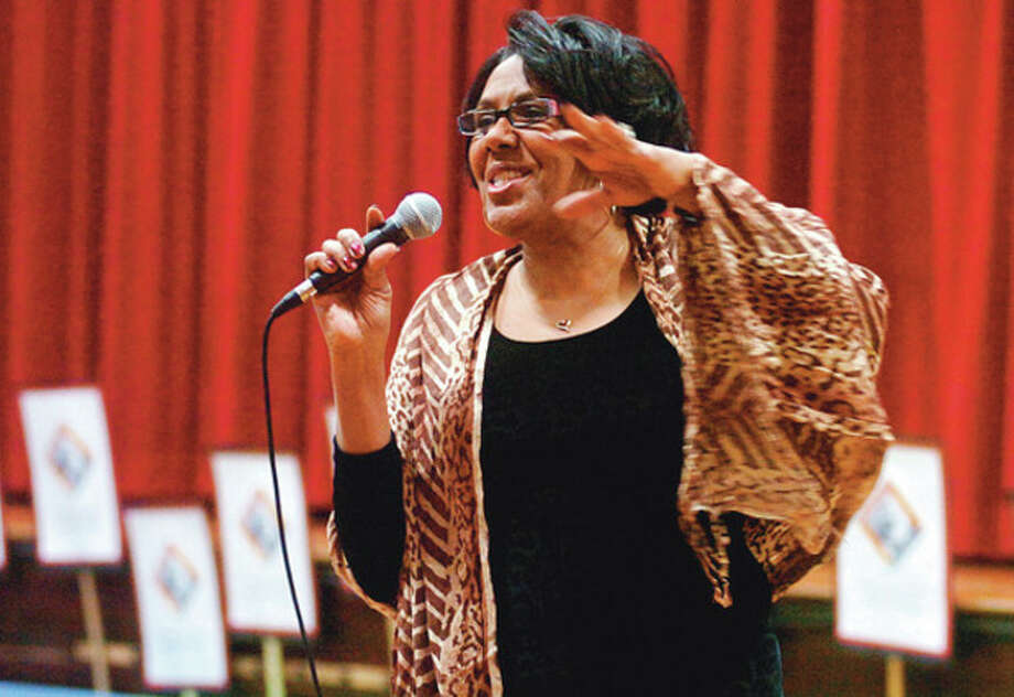 Professional actress, singer and writer, KImberly Wilson, perfoms the words of poet Maya Anjalou during the Columbus Magnet School's 2012 MLK Peace Games Friday. Hour photo / Erik Trautmann / (C)2011, The Hour Newspapers, all rights reserved