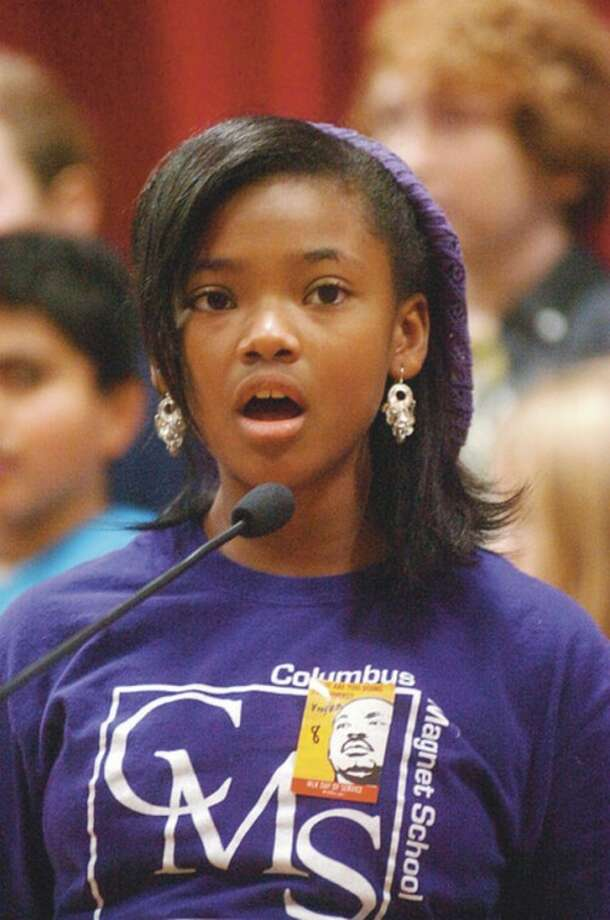 Columbus Magnet School fifth grader Kaylan Walcott and the 4th and 5th grade chorus sing Road to Freedom participates in the movement activity as part of the school's 2012 MLK Peace Games Friday. Hour photo / Erik Trautmann