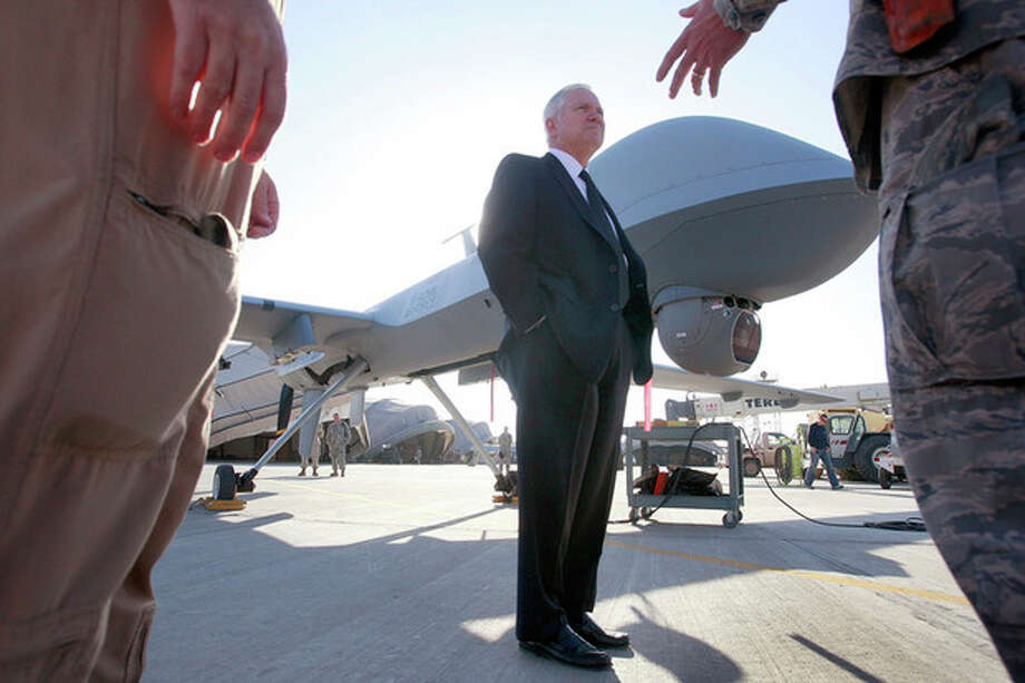 FILE - In this Dec. 11, 2008 file photo Defense Secretary Robert Gates stands by an unmanned aerial vehicle (UAV) at Kandahar Air Field in Kandahar, Afghanistan. Gates, a former defense secretary and spy chief, is backing lawmakers' proposal to form a special court to review President Barack Obama's deadly drone strikes against Americans linked to al-Qaida. Gates said Obama's use of the unmanned and lethal drones follows tight rules, but he shares lawmakers' wariness over using drones to target al-Qaida operatives and allies from the sky. (AP Photo/Scott Olson, Pool) / POOL Getty Images