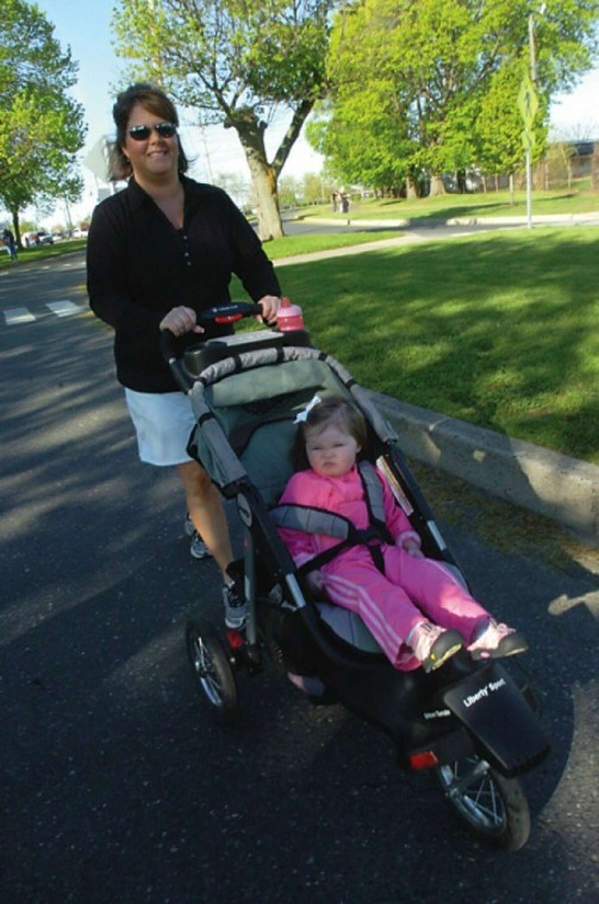 Eileen Donellan- Pinkering with her daughter Jaqueline 2, at the Mother''s Day Road Race Sunday at Calf Pasture Beach. hour photo/matthew vinci