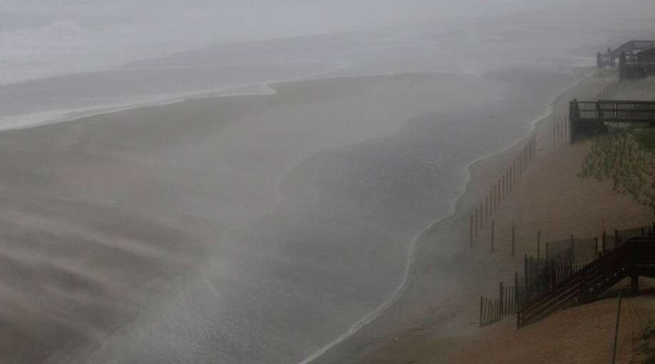 Wind and water whip across the beach as the effects of Hurricane Irene are felt in Nags Head, N.C., Saturday, Aug. 27, 2011 (AP Photo/Gerry Broome) / AP