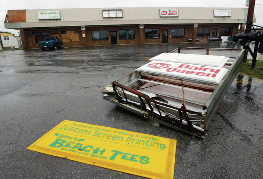 A sign torn down by hurricane winds is shown in a parking lot in Atlantic Beach, N.C., Saturday, Aug. 27, 2011 as Hurricane Irene hits the North Carolina coast. (AP Photo/Chuck Burton) / AP