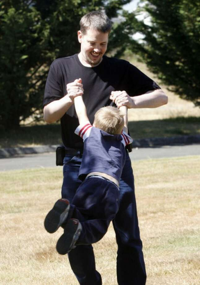 In this Aug. 19, 2011 photo, Josh Powell plays with his son Braden in a park near his home, in Puyallup, Wash. Powell had long been a person of interest in his wife's disappearance from their home in West Valley City, Utah, two years ago. When Powell's two sons arrived Sunday, Feb. 5, 2012, for a court-ordered, supervised child custody visit with their father, Powell barred a social worker from entering and then torched the house. All three died. (AP Photo/The Salt Lake Tribune, Rick Egan) DESERET NEWS OUT; LOCAL TV OUT; MAGS OUT; MANDATORY CREDIT