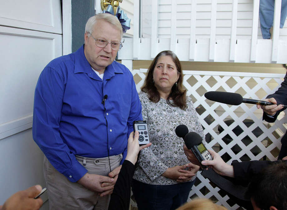 Chuck and Judy Cox, the parents of missing Utah mother Susan Cox, talk to reporters at their home in Puyallup, Wash., Monday, Feb. 6, 2012. The Cox's two grandsons, Charlie and Braden, were killed Sunday along with their father, Josh Powell, in what police said appeared to be a deliberately set fire. Susan Cox went mysteriously missing from West Valley City, Utah, home in December 2009. (AP Photo/Ted S. Warren) / AP