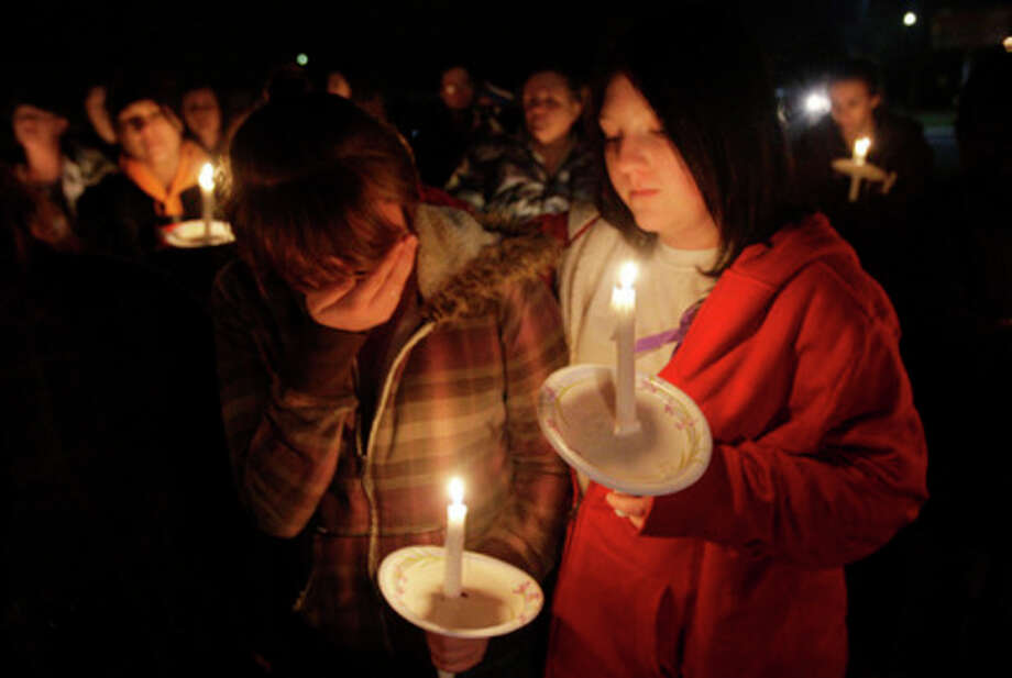 Stromee Ryan and Shayanna Smith along with Powell family friends and well wishers attend a candlelight vigil in Salt Lake County, Utah, Sunday, Feb. 5, 2012. Days after a judge ruled against Josh Powell in a child custody hearing, Powell and his two young sons were killed Sunday when police said he intentionally blew up a house with all three inside -- a tragic ending to a bizarre case that began more than two years ago when Powell's wife Susan went mysteriously missing in Utah. (AP Photo/Deseret News, Jeffrey D. Allred) / Jeffrey D. Allred