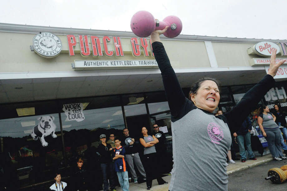 "Lillian Tropea, mother of Punch Kettlebell Gym co-owner and head trainer Stefanie Tropea, lifts a dumbbell Sunday during the ""Battle of the Belles"" strongwoman competition held to benefit the Bennett Cancer Center at Stamford Hospital. / (C)2011, The Hour Newspapers, all rights reserved"