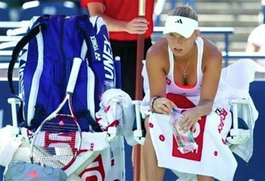 Caroline Wozniacki, of Denmark, rests during a break in her match against Roberta Vinci, of Italy, at the Rogers Cup tennis tournament in Toronto on Wednesday, Aug. 10, 2011. Vinci won 6-4, 7-5. (AP Photo/The Canadian Press, Darren Calabrese) / The Canadian Press