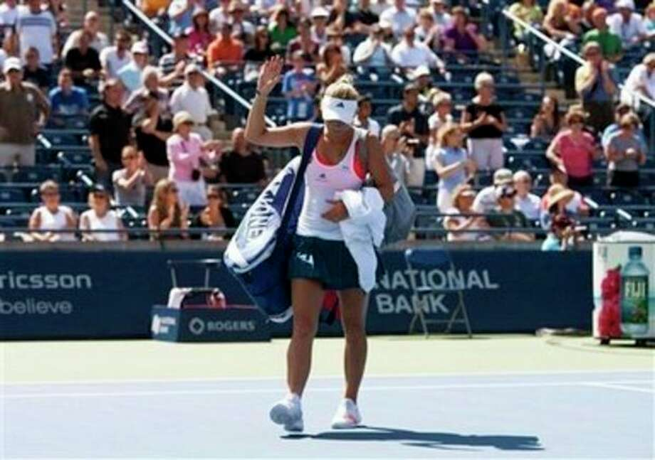 Caroline Wozniacki, of Denmark, leaves the court after a 6-4, 7-5 loss to Roberta Vinci, of Italy, at the Rogers Cup tennis tournament in Toronto on Wednesday, Aug. 10, 2011. (AP Photo/The Canadian Press, Darren Calabrese) / The Canadian Press