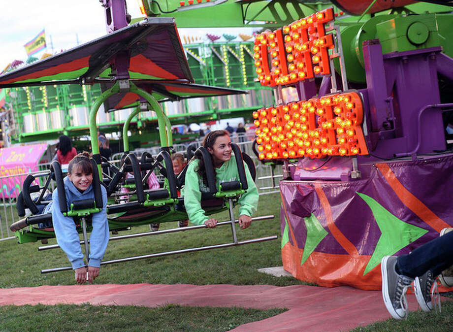 Lilliana Garcia and Tess St. John enjoy a ride on the Cliff Hanger at the annual Oyster Festival in Norwalk in 2010. Hour Photo / Danielle Robinson