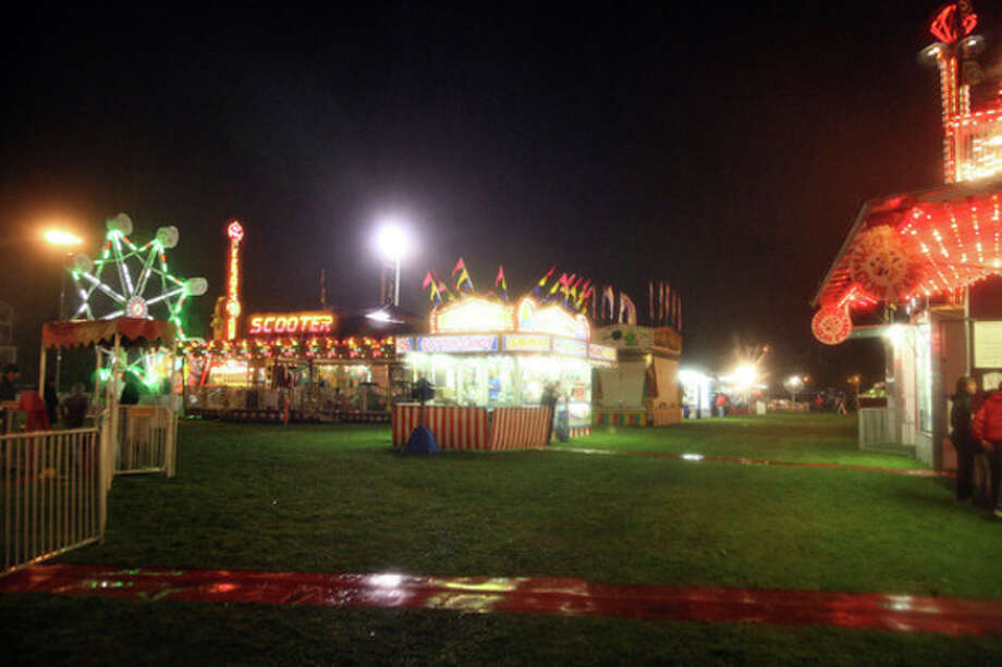 Oyster Festival Rides were empty Friday evening due to rain.
