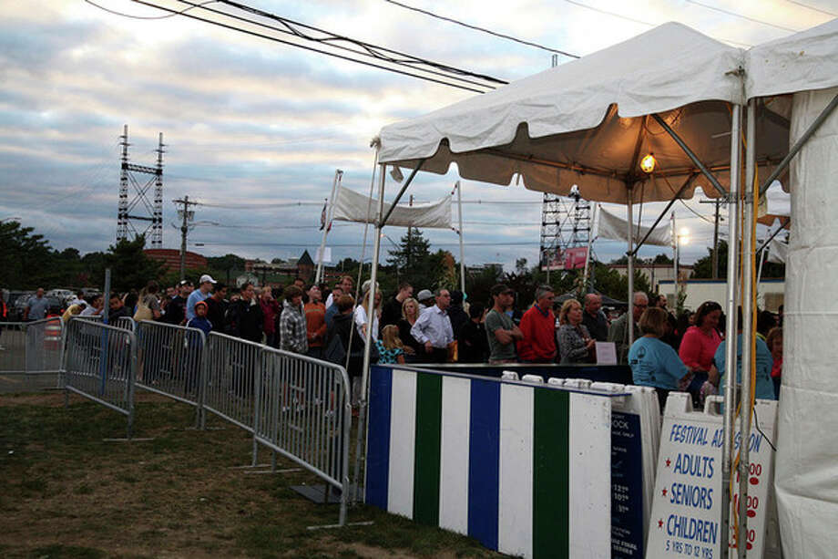 A crowd waits in line to enter the Oyster Festival at Veteran's Park in Norwalk in 2010. Hour Photo / Danielle Robinson