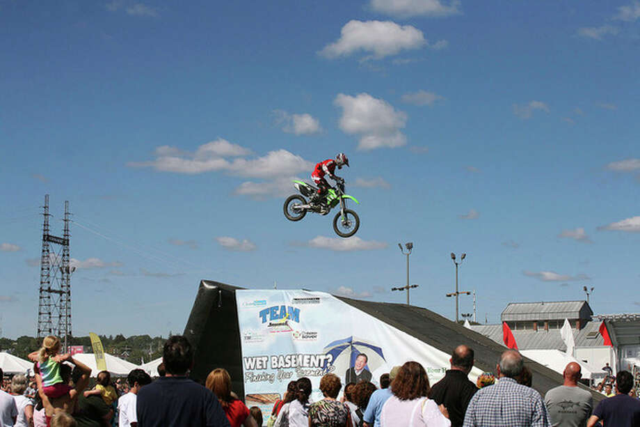 A bike jumps to the thrill of the crowds atthe 2010 Oyster Fest.