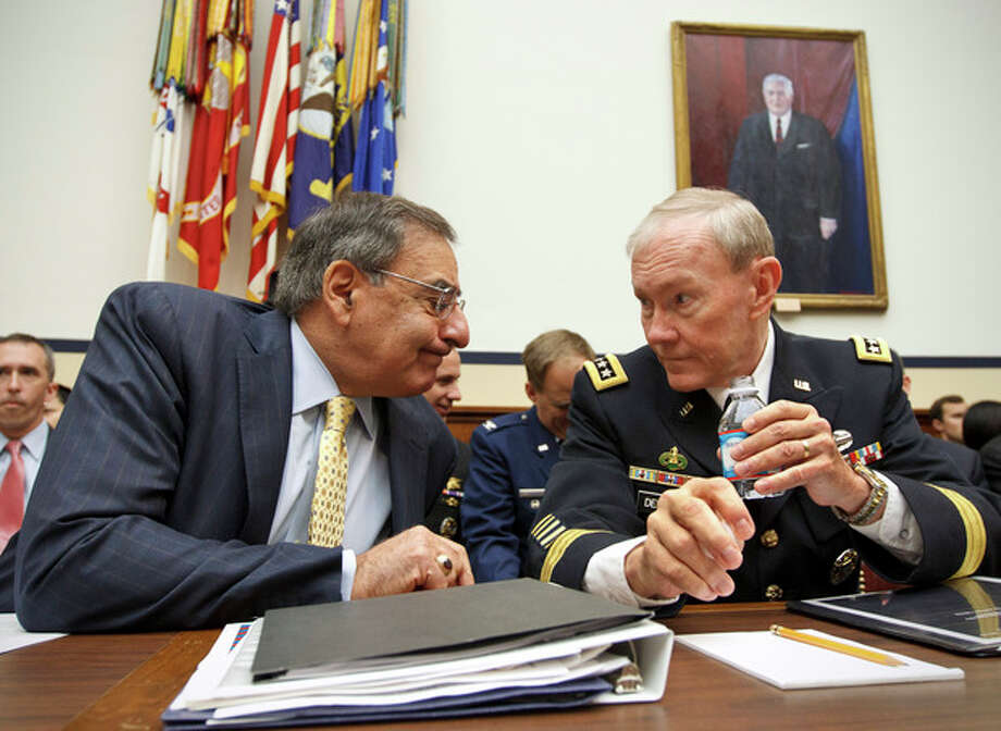 Defense Secretary Leon Panetta and Joint Chiefs Chairman Gen. Martin Dempsey confer on Capitol Hill in Washington, Thursday, April, 19, 2012, prior to testifying before the House Armed Services Committee hearing on recent developments with the crisis in Syria. (AP Photo/J. Scott Applewhite) / AP