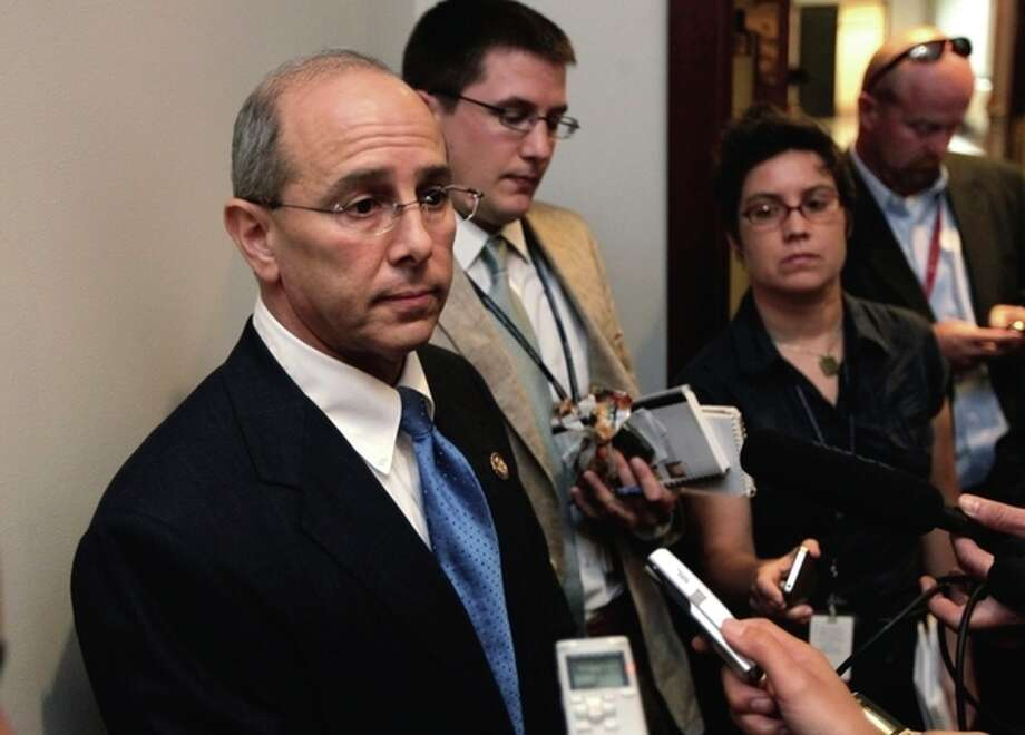 Rep. Charles Boustany, R-La., speaks with reporters after a closed-door meeting at the Capitol with economists from Standard & Poors on the the potential negative impact to America's credit rating if Congress does not reach a deficit reduction agreement, in Washington, Thursday, July 21, 2011. (AP Photo/J. Scott Applewhite) / AP