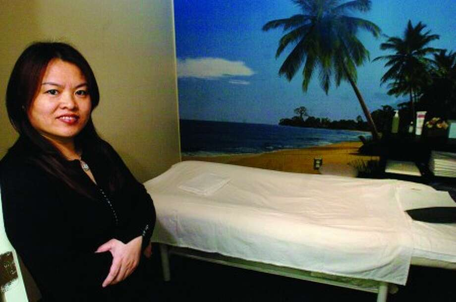 Hour photo / matthew vinci Helen Zhu is owner of Merritt Massage, one of the four Norwalk businesses that has responded to the Norwalk Department of Health mailing.