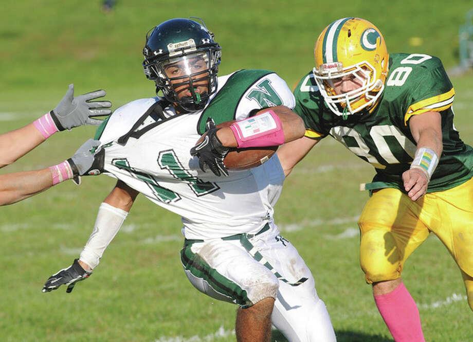 Norwalk football team overcomes sluggish start, scores 26 unanswered points, to down Trinity Catholic