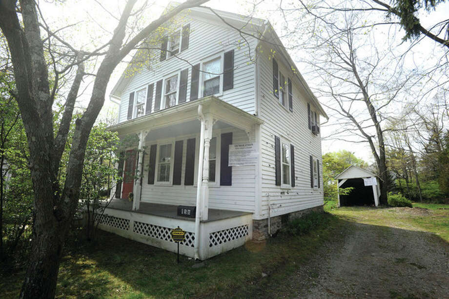 Hour photos / Matthew VinciAbove left is 158 Compo Road South in Westport, and above right is 108 Cross Highway in Westport, two historic homes that are slated for demolition.