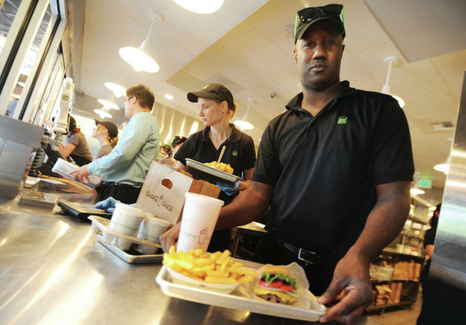 Dave Yearwood general manager of the Westport Shake Shack at the new location on the Post Road East. hour photo/matthew vinci
