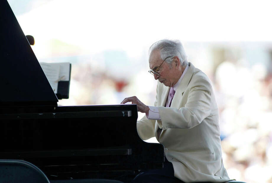 FILE - In this Aug. 8, 2010 file photo, Dave Brubeck plays at the CareFusion Newport Jazz Festival in Newport, R.I. Brubeck is among the featured artists scheduled to return to the festival on Sunday, Aug. 7, 2011. (AP Photo/Joe Giblin, File) / AP2010