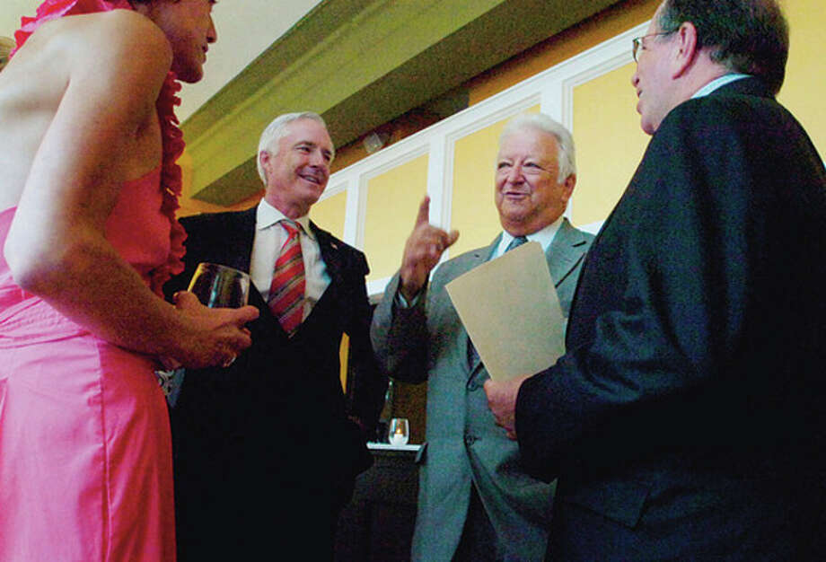 Brigeport Mayor Bill Finch and Norwalk Mayor Richard Moccia chat at the US Conference of Mayors at the Bijou Theater in Bridgport Tuesday with Finch's wife Sonya and Mayor of Chicopee, Massachussetts, Michael Bissonnette. / ©2010 The Hour Newspapers