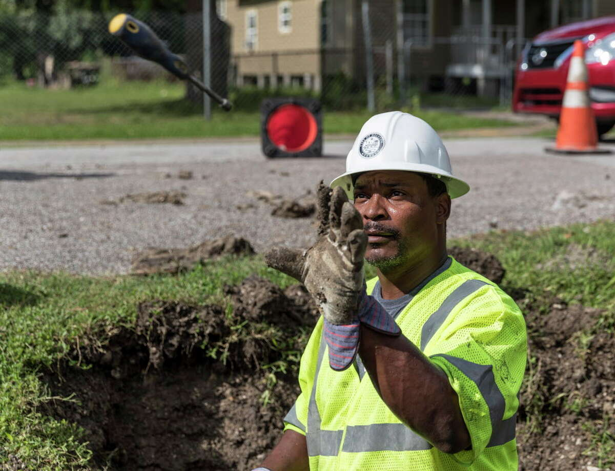 Michael Riggs works to repair a sewer line in the 5400 block of Pardee Street in Houston, TX on Saturday, June 11, 2016.