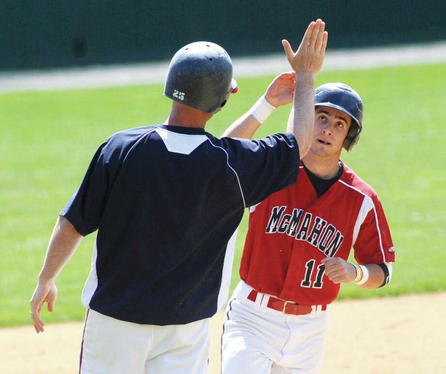 Hour photo/John NashBrien McMahon's Bryan Daniello, right, gets a high five from head coach John Cross as he jogs around third base after Daniello hit a two-run home run in the first inning of Friday's FCIAC game against Fairfield Warde at Doubleday Field in Cooperstown, N.Y. McMahon shut out Warde, 9-0.,