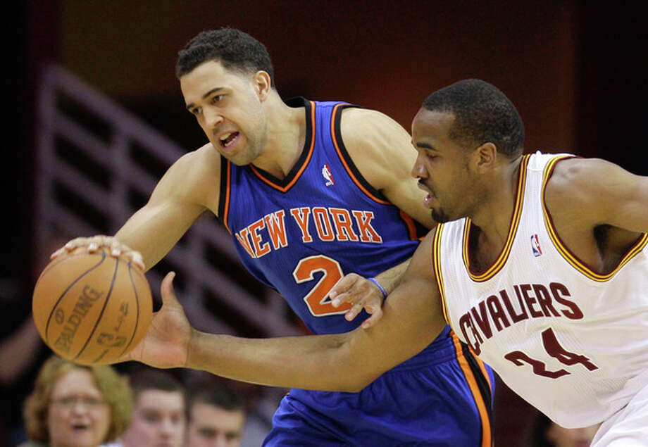 New York Knicks' Landry Fields (2) and Cleveland Cavaliers' Samardo Samuels (24) battle for a loose ball in the first quarter in an NBA basketball game on Friday, April 20, 2012, in Cleveland. (AP Photo/Tony Dejak) / AP 2010