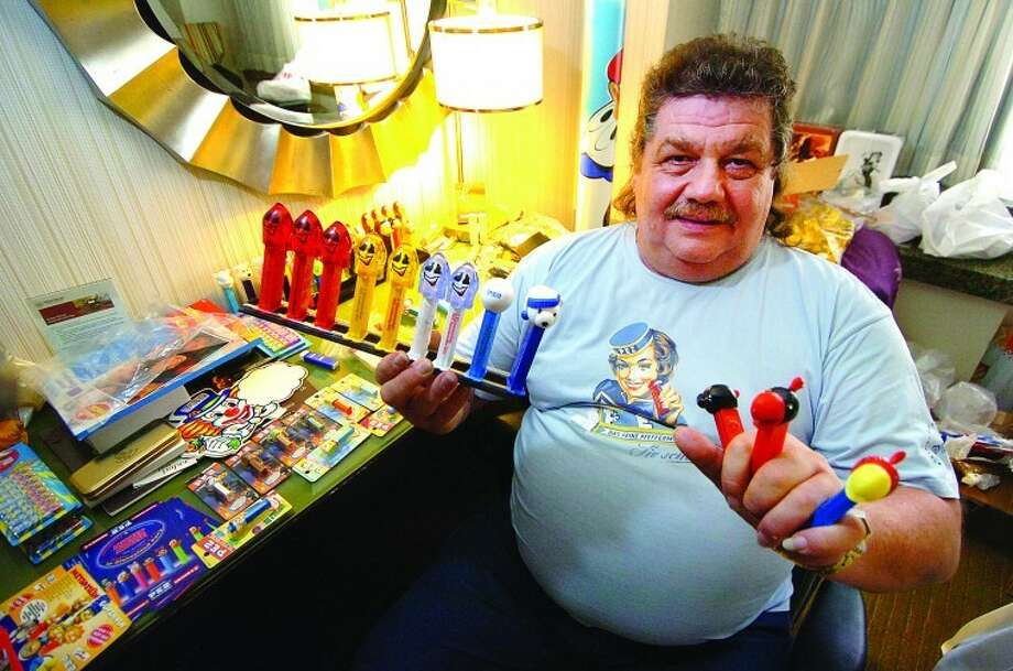 Hour Photo/ Alex von Kleydorff. Gunther Haidinger, Chairman of the Austrian Pez Collectors Club flew from his hometown of Linz Austria for the 2012 Pez collectors gathering in Stamford. Among the thousands of Pez related items He brought with him he shows Pez dispensers made specifically for the charity auction and also some extremly rare production test models that were made to test new dispenser molds.