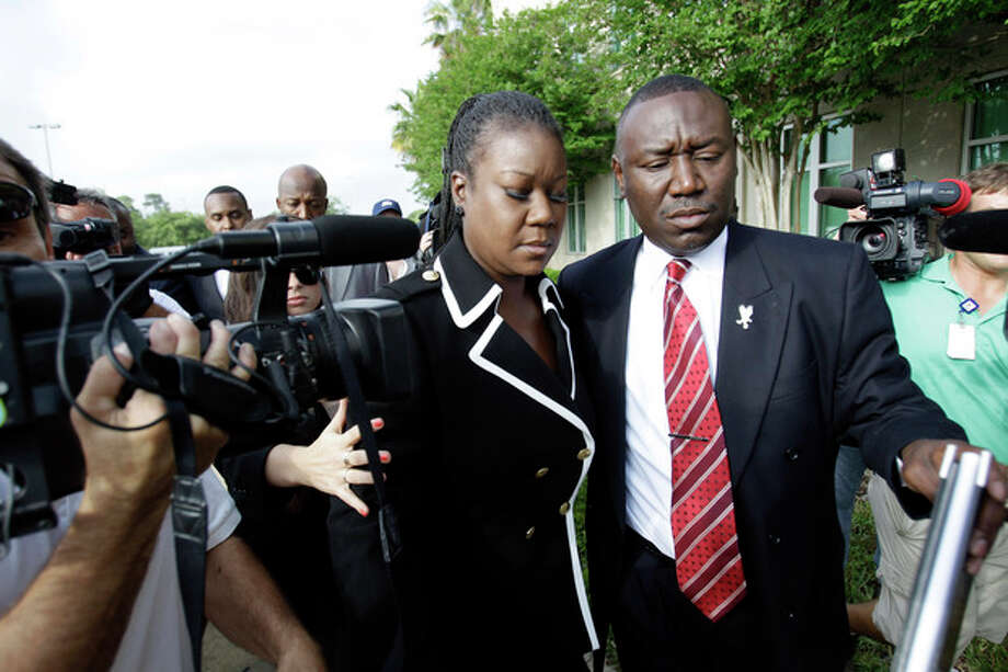 Sybrina Fulton, left, mother of Trayvon Martin and attorney Benjamin Crump, arrive at the Seminole County Criminal Justice Center for a bond hearing for George Zimmerman, the neighborhood watch volunteer charged with murdering Trayvon Martin, Friday, April 20, 2012, in Sanford, Fla. Zimmerman's attorney is asking the Seminole County judge to let Zimmerman post bail at the hearing Friday. (AP Photo/John Raoux) / AP