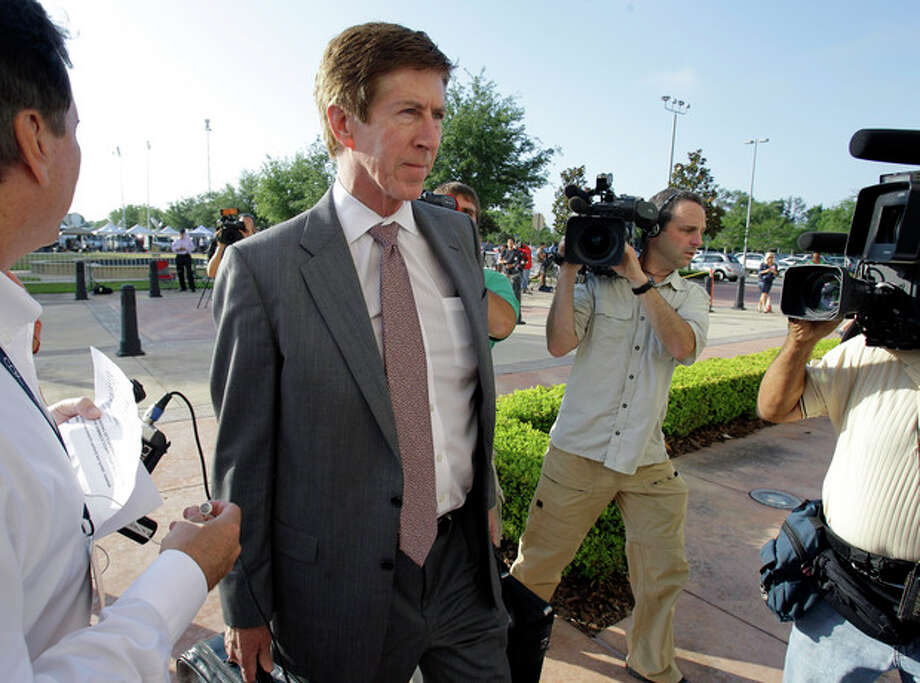 Attorney Mark O'Mara arrives at the Seminole County Criminal Justice Center for the bond hearing of his client George Zimmerman, the neighborhood watch volunteer charged with murdering Trayvon Martin, Friday, April 20, 2012, in Sanford, Fla. O'Mara is asking the Seminole County judge to let Zimmerman post bail at the hearing Friday. (AP Photo/John Raoux) / AP