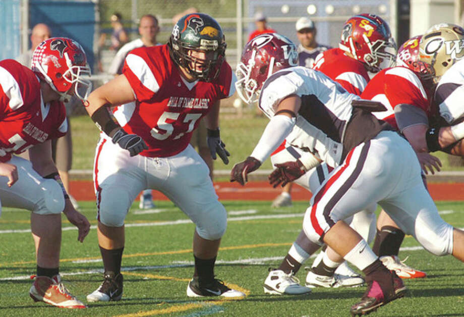 Hour Photo/Erik Trautmann Norwalk HighÕs Evan Opdahl (57) gets set to battle at the line of scrimmage during SaturdayÕs Hall of Fame Classic in West Haven. / ©2010 The Hour Newspapers