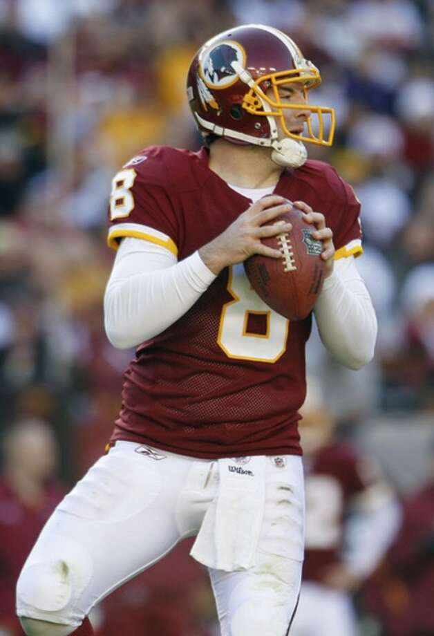 Washington Redskins quarterback Rex Grossman looks for a receiver during the first half of an NFL football game against the New York Jets in Landover, Md., Sunday, Dec. 4, 2011. (AP Photo/Evan Vucci)